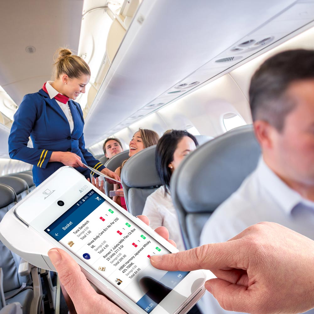 Crew using Novo mobile payment terminal in-flight